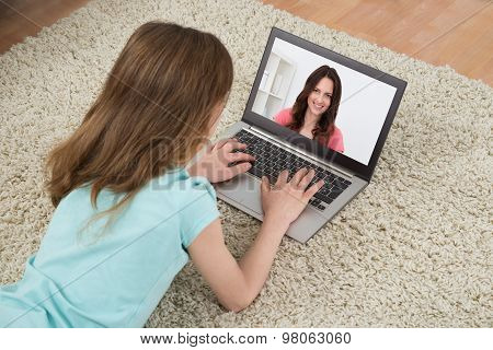 Girl Video Chatting On Laptop