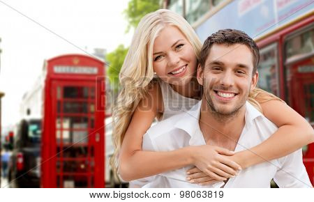summer holidays, travel, tourism, people and dating concept - happy couple hugging over london city street background