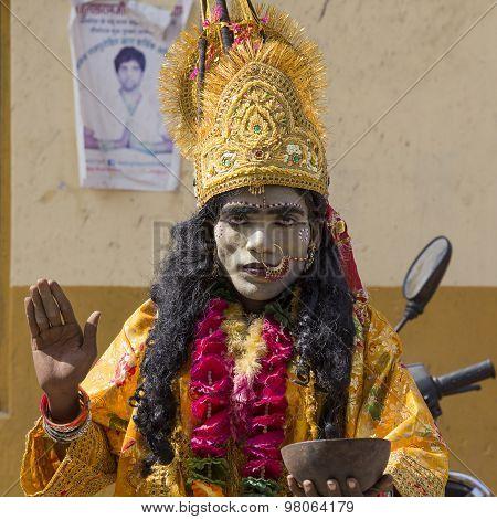 Indian Sadhu In Mythological Clothing Blesses The People On The Street. Pushkar , India