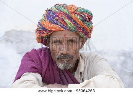 Indian Man On The Ghat Along The Sacred Sarovar Lake In Pushkar, India