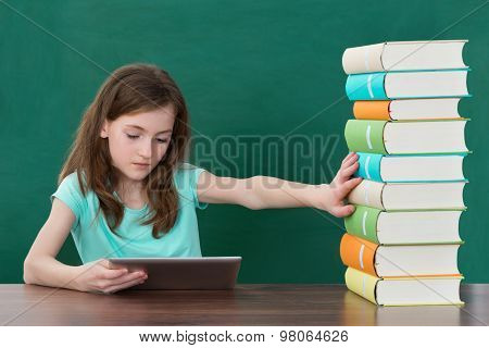 Girl Using Digital Tablet And Avoiding Books