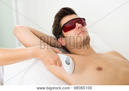 Person Hands Giving Laser Epilation Therapy To Man