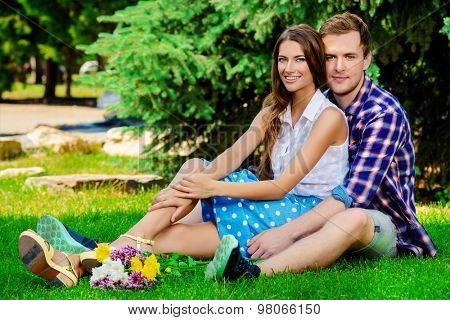 Beautiful young couple in love. Romantic summer day.