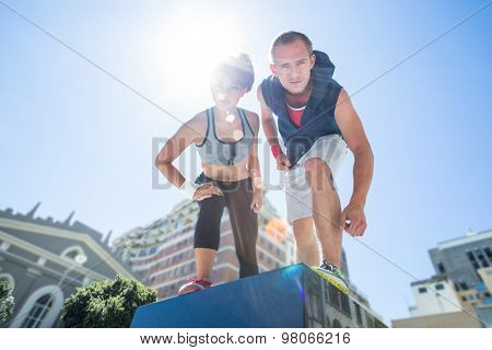 Portrait of a couple preparing to parkour on a sunny day