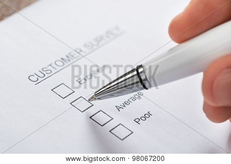 Person Hands Filling Customer Survey Form