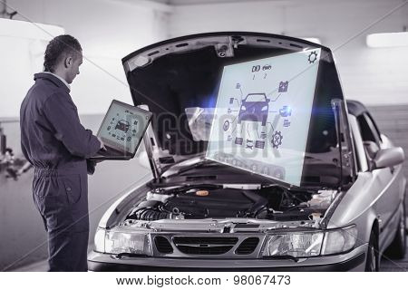 Engineering interface against mechanic typing on a computer next to a car