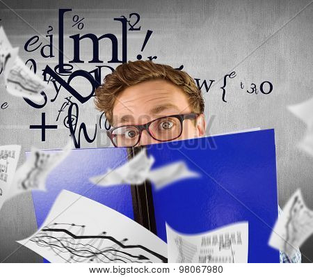 Geeky student reading a book against white and grey background