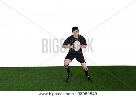 Rugby player running with the rugby ball on a white background