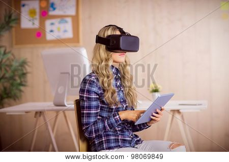 Pretty casual worker using oculus rift in her office