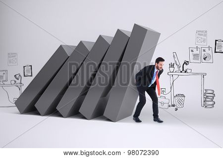 Businessman in suit carrying something heavy against falling blocks