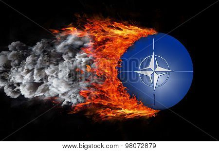 Flag With A Trail Of Fire And Smoke - Nato