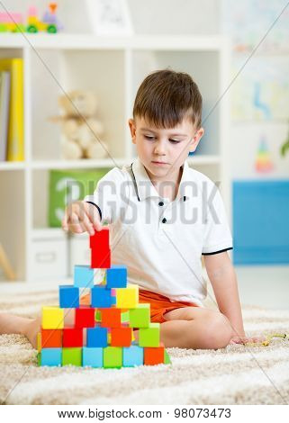 Child playing with blocks in the kindergarten