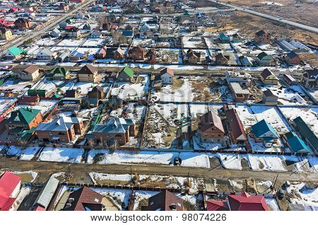 Aerial view on suburban street at spring