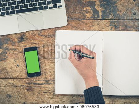 Hand Writing In Notepad By Laptop And Smart Phone