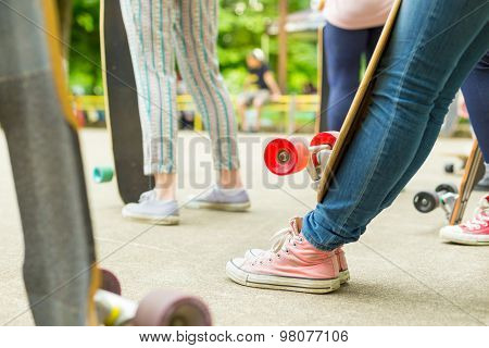 Teenage girl practicing riding long board.