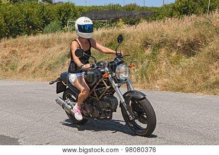 Girl Riding Italian Motorbike Ducati