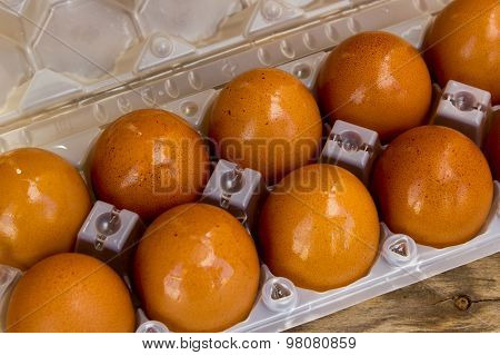 Eggs In Box On A Wooden Table