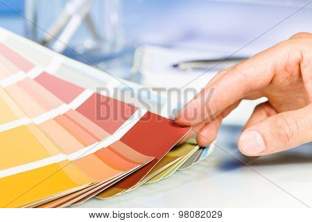 Artist Hand Browsing Color Samples In Palette