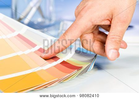 Artist Hand Pointing With Finger To Color Samples In Palette
