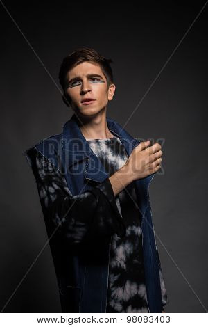 Professional game young actor.  photo on a dark background.