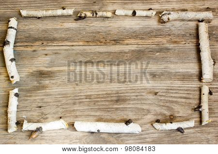 Birch Tree Trunks And Branches On Natural Wood Background. Copy Space To Right.