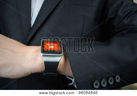 Businessman Receives Message Notification On Smart Watch