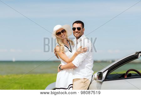 transport, travel, love, date and people concept - happy man and woman hugging near cabriolet car at sea side