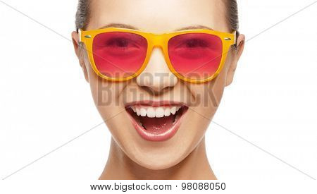 happiness and people concept - portrait of happy teenage girl in shades