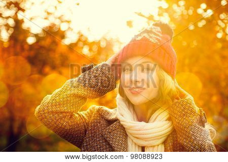 Young Woman in Beanie Hat on Autumn Background