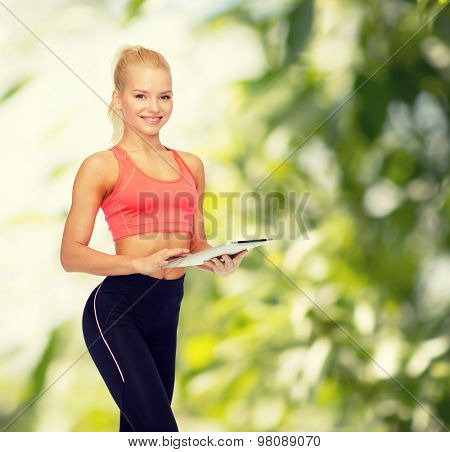 sport, exercise, technology, internet and healthcare - smiling sporty woman with tablet pc computer