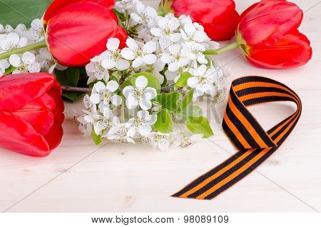 Flowering Cherry Branch With Tulips And St. George Ribbon