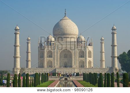 People explore Taj Mahal mausoleum at sunrise in Agra, India.