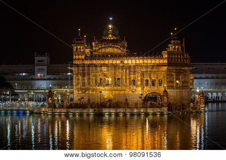 Golden Temple In Amritsar At Night.  India