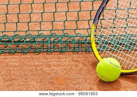 Tennis racket and ball on the court.