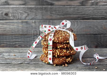 Chocolate Cookies Tied With Christmas Ribbon. Oat Cookies With Nuts, Sesame And Chocolate On Wood
