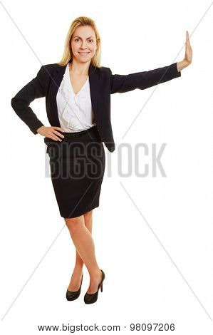 Young happy businesswoman leaning smiling on an imaginary wall