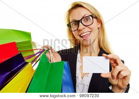 Happy woman with many shopping bags holding an empty credit card