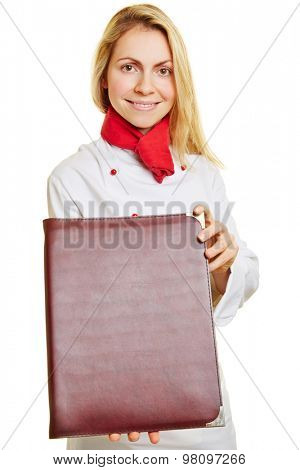 Smiling woman as chef cook with the menu in her hands
