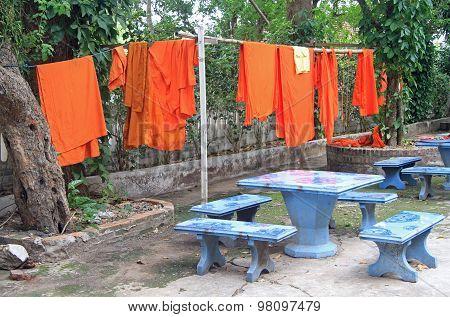 Buddhist monks laundry with orange robes