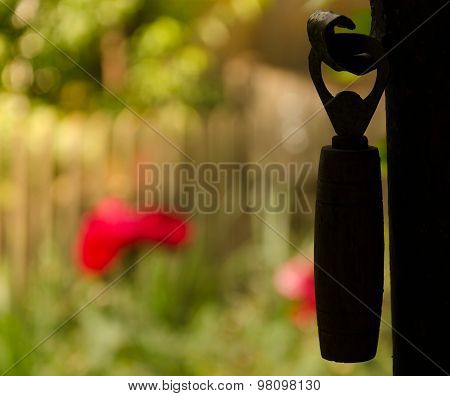 silhouette of a hanging bottle opener