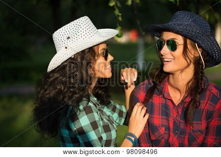 sexy girl in cowboy hats and plaid shirts. sunglasses