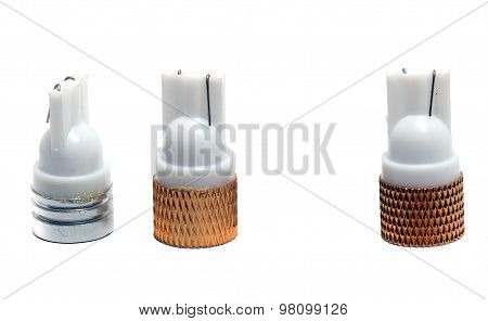 Three Small Led Bulbs On A White Background