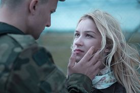 picture of say goodbye  - Soldier saying goodbye to beauty upset wife - JPG