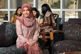 picture of muslim  - Portrait of young Muslim woman with headscarf inside college building on campus - JPG