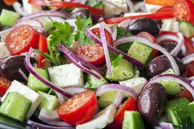 stock photo of cucumbers  - Greek salad in full frame - JPG