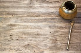 pic of calabash  - Calabash and bombilla with yerba mate on wooden background - JPG
