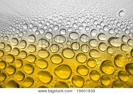 Beer glass with water drops