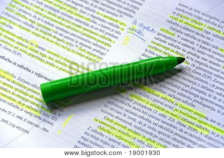 Pen on markered education text