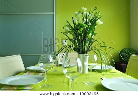 Formal table setting in a modern dining room