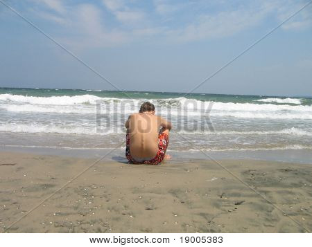 a man sitting on the beach